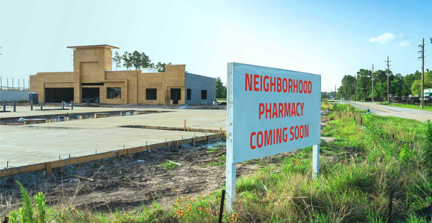 """Image of a sign that says """"Pharmacy Coming Soon"""""""