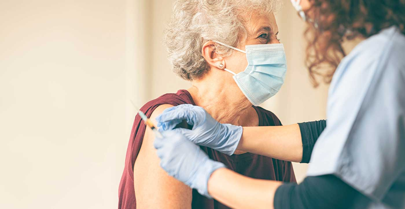 Image of woman vaccinating patient