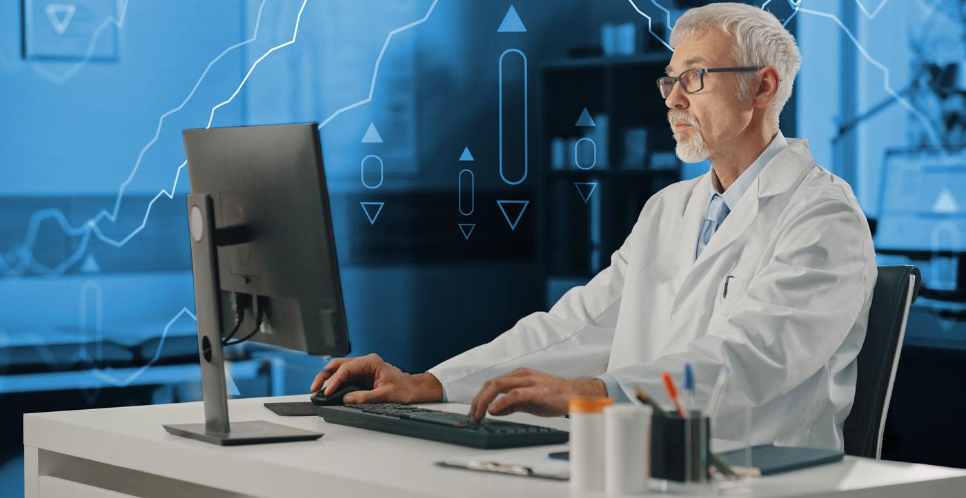 Image of man sitting on desktop