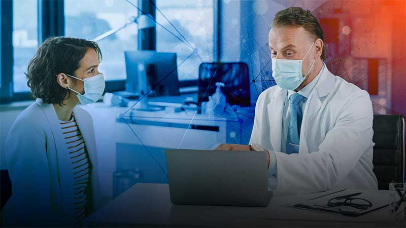 Two pharmacists wearing masks