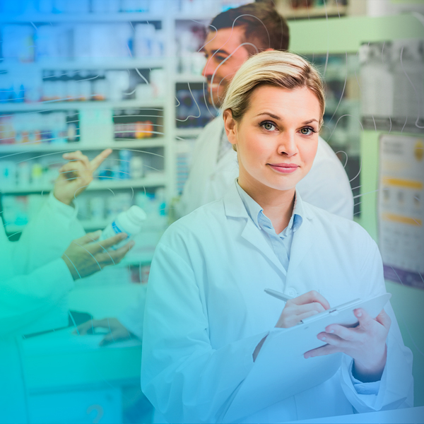 Pharmacist with notepad in a pharmacy