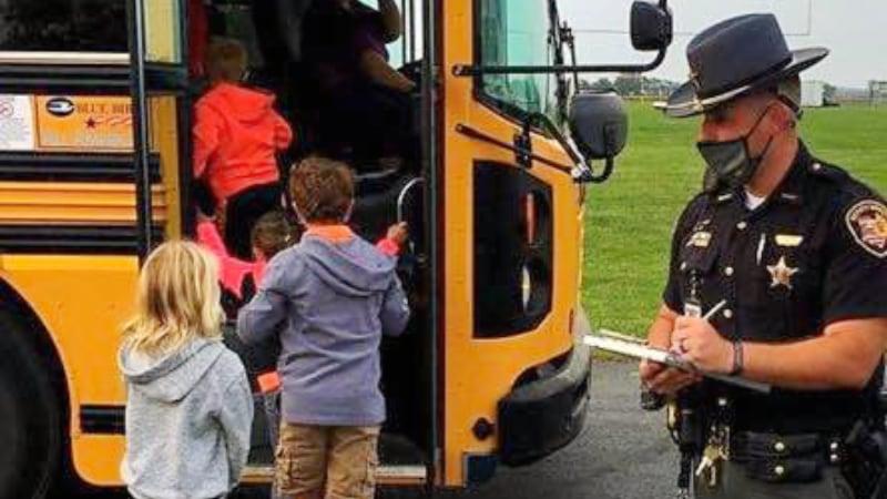 School Resource Officer loading School Bus