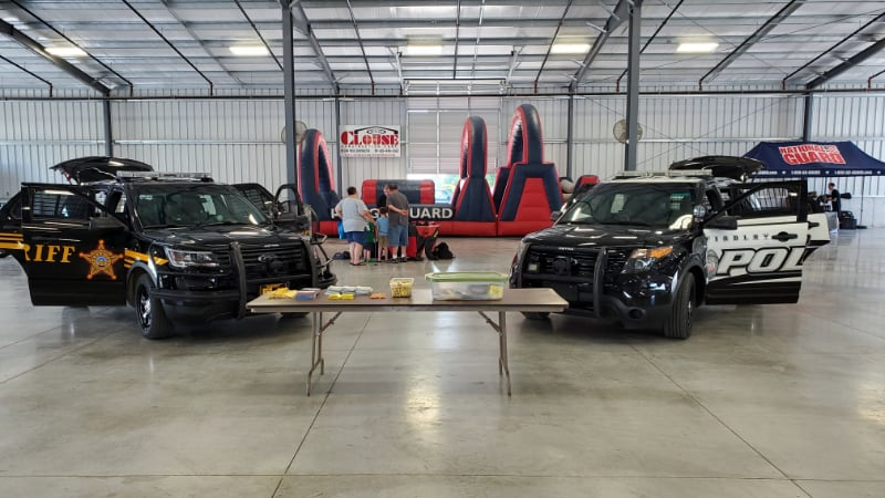 Police and Sheriff vehicles in event venue