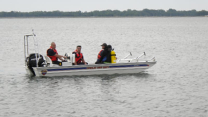 Sheriff's Dive Team members in boat