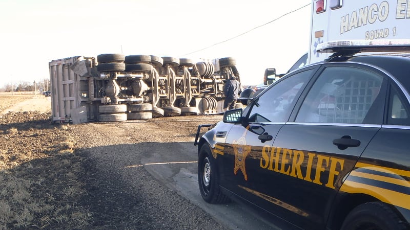 Overturned semi with Sheriff Car