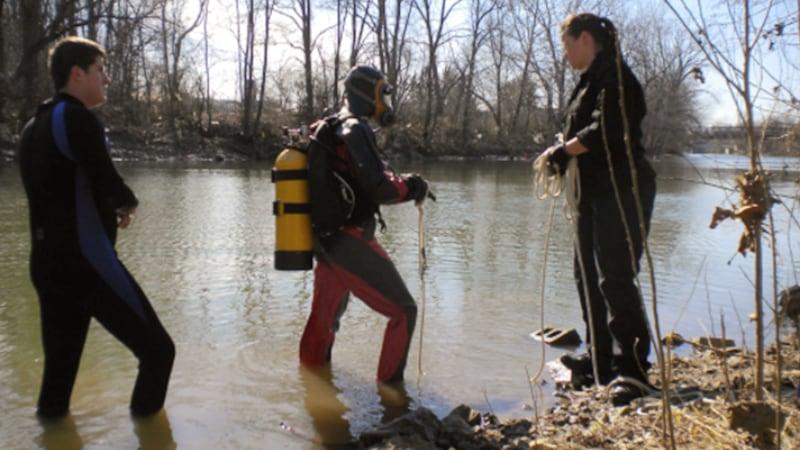 Sheriff's Dive Team members standing in river