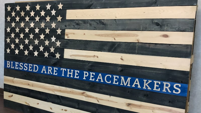 """Wooden American flag with words, """"Blessed are the Peacemakers"""""""