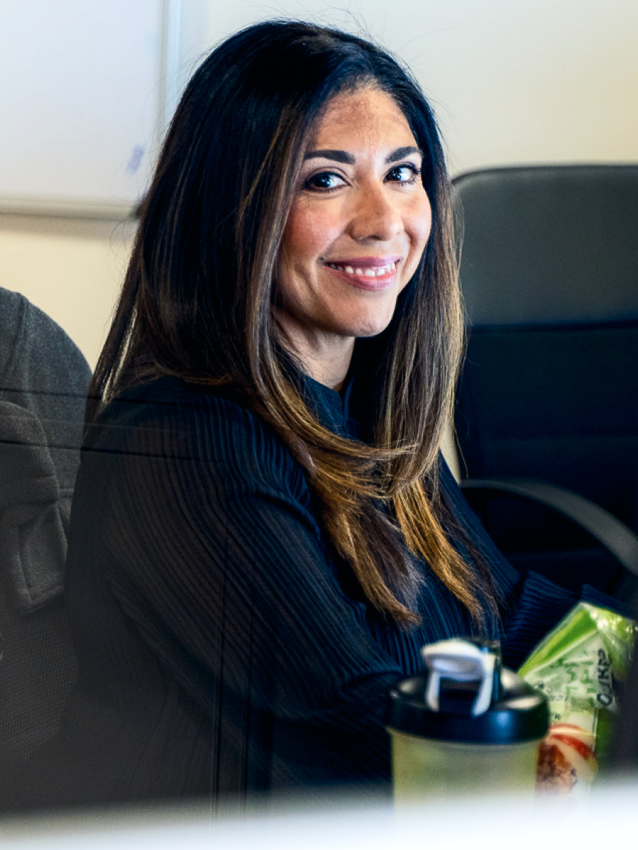 Dura employee smiling at desk