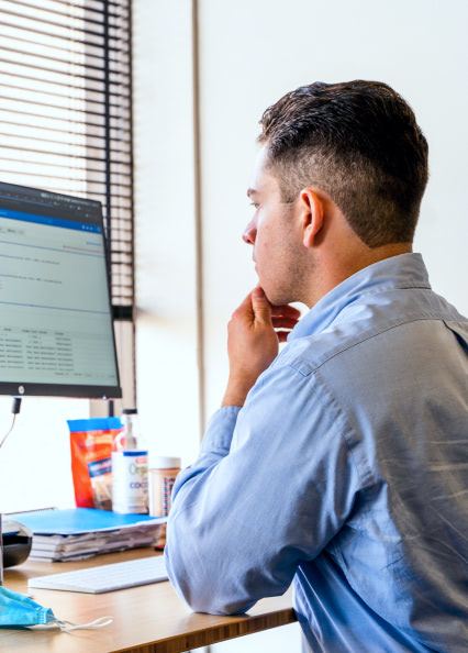 Side view of Dura employee at a desk sitting focused on computer work