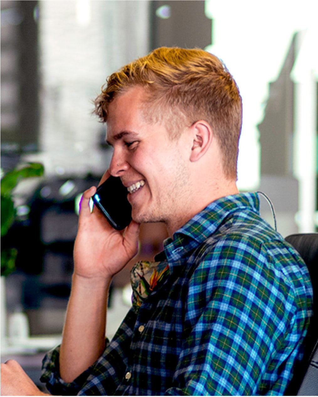 Laughing young man on phone