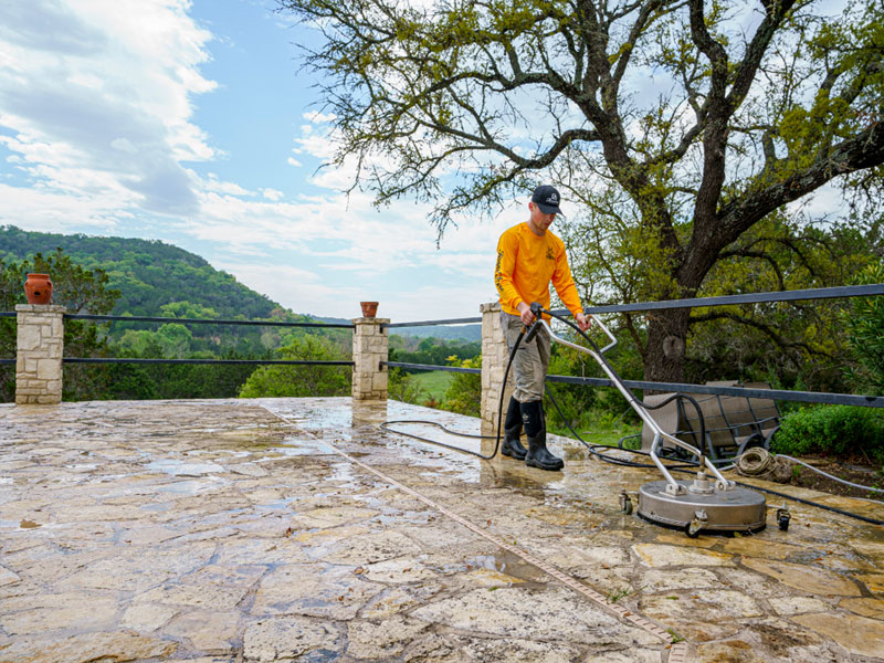A pressure washing machine cleaning a exterior patio in Kerrville.