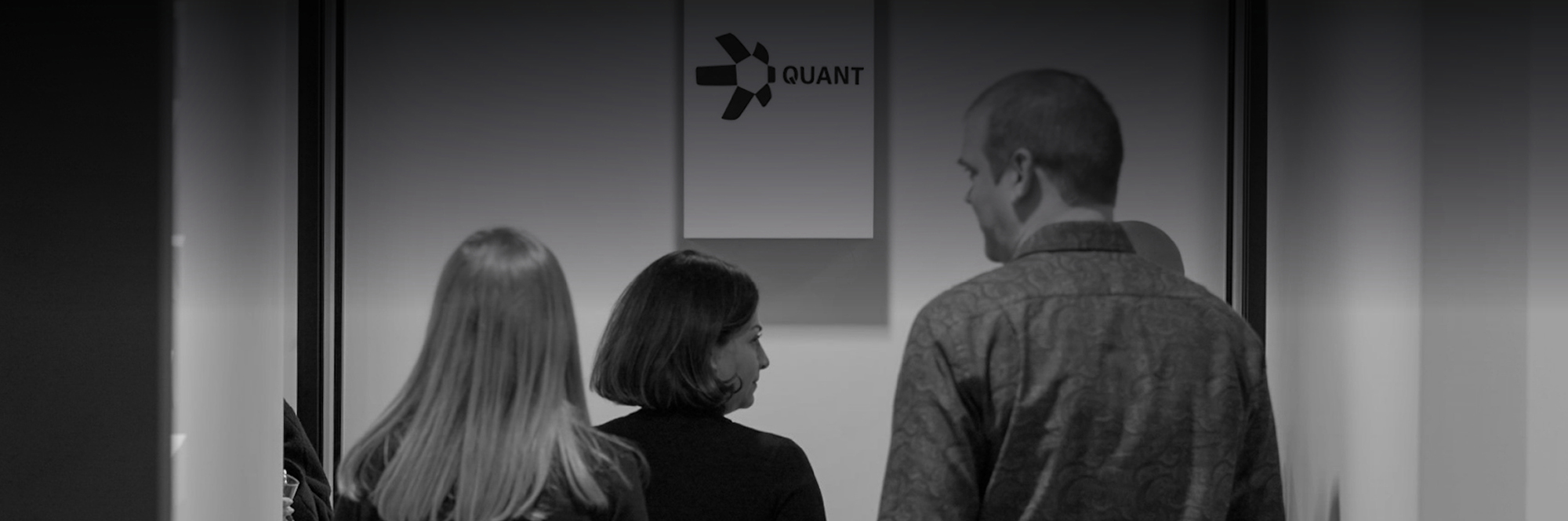 job offerings at Quant, members of management team, Quant sign, dark logo on white background