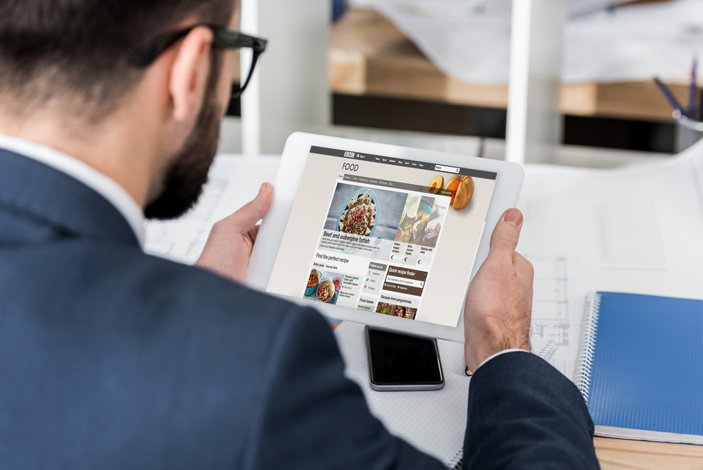 Man looking at a tablet with optimized images
