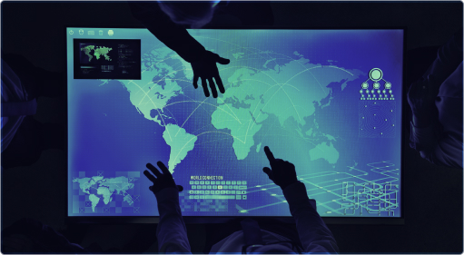 Photo of hands using a touchscreen map of the world
