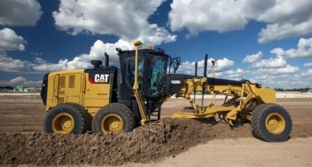 cat grader processing soil