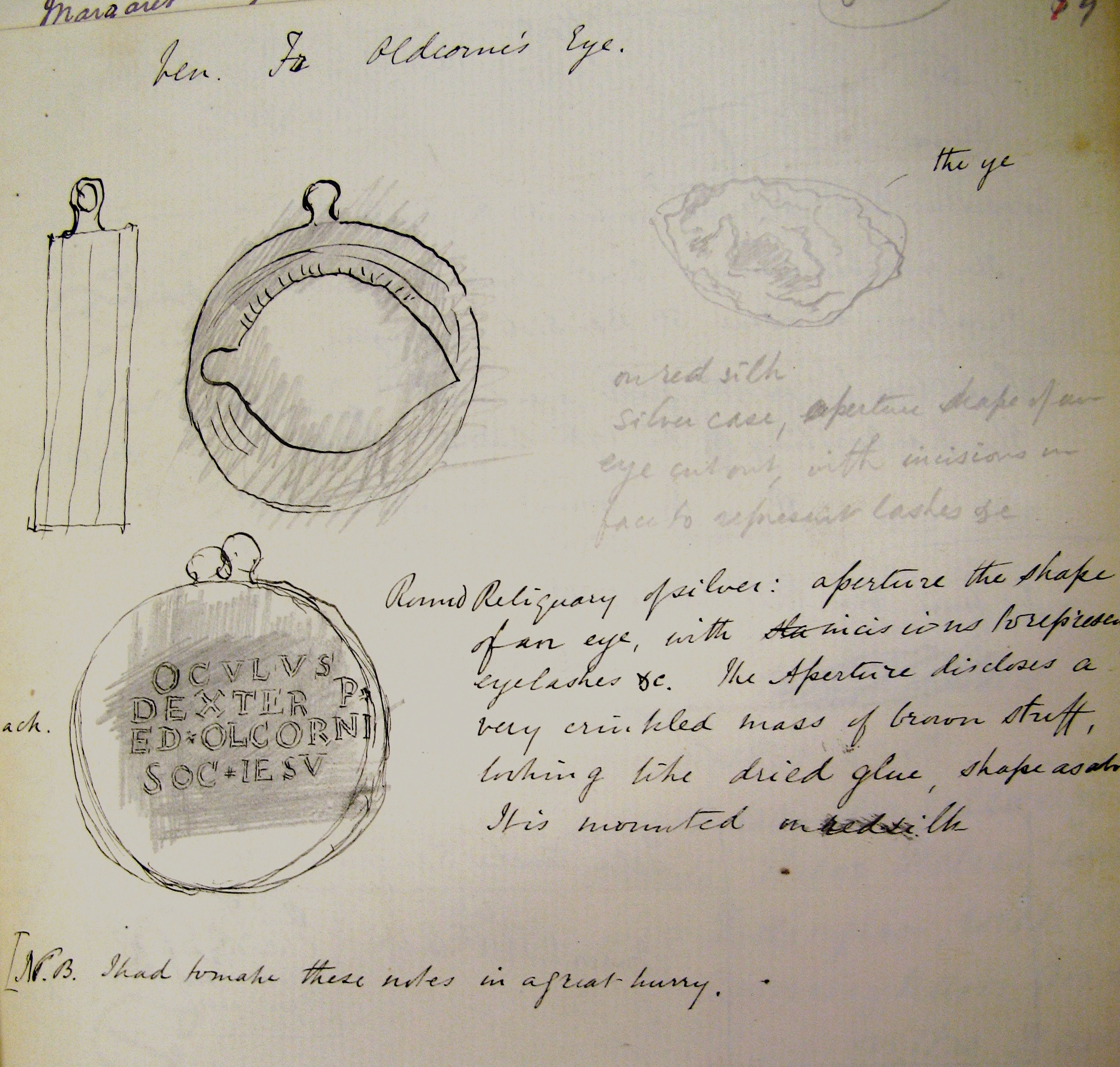 Page of handwritten notes with sketches. Main two sketches are of round reliquary and reverse, which has pencil rubbing of inscription found on it. There is also a pencil sketch of the eye.