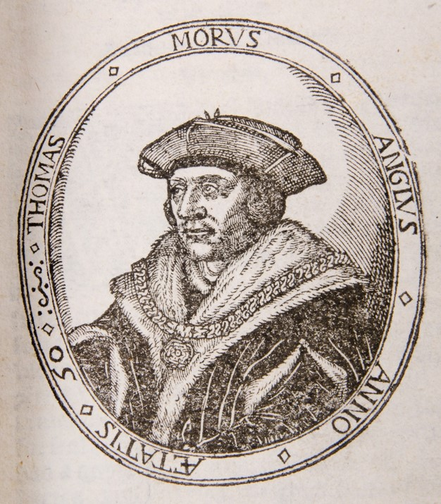 Picture of a man wearing a hat and large chain over what appears to be a fur trimmed cloak. It is framed by an oval border with the inscription Thomas Morus Anglus Anno Aetatis