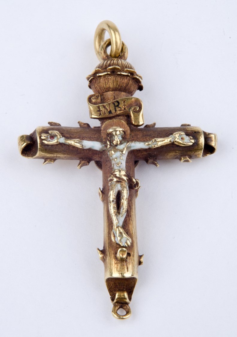 Photo of golden crucifix with enamel Christ figure. The cross appears to have thorns and at top there is a hoop for attaching it. White background.
