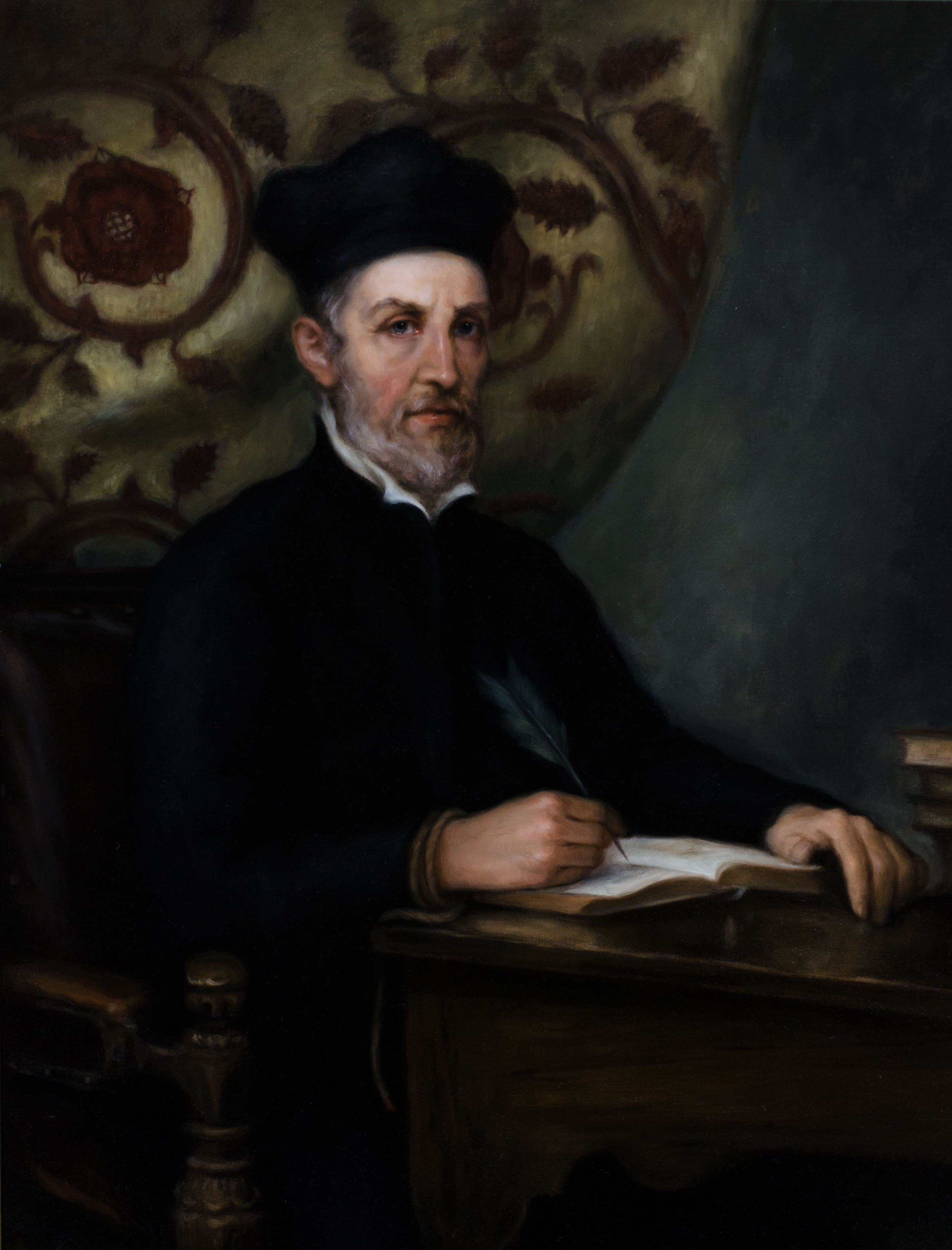 Painting of a white man with a greying beard and wearing a biretta looking directly at viewer. He is sat at a desk writing into a book using a quill. Around his right wrist is a cord.