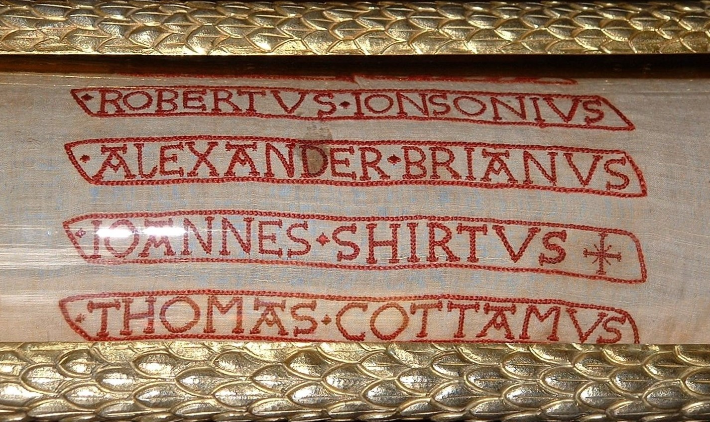 Colour photograph showing close up the names in red stitching with each name surrounded by a red stitched box. The names are: Robertus Ionsonius, Alexander Brianus, Ioannes Shirtus and Thomas Cottamus.