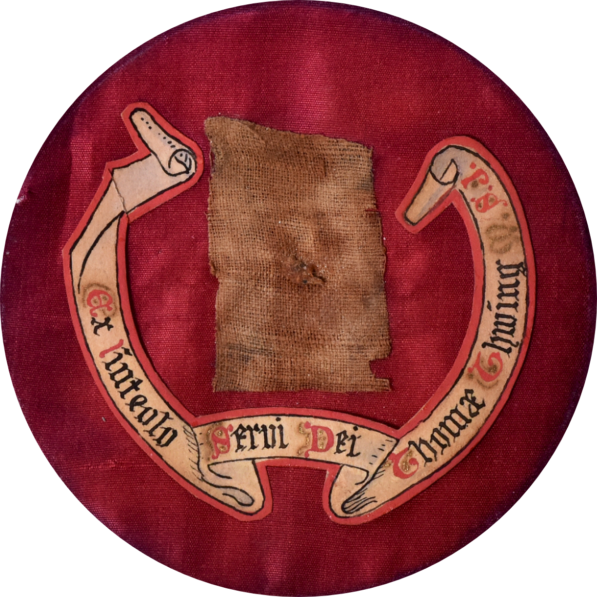 Round photo with a rough faded red rectangle piece of fabric on a red velvety background. Around sides and bottoms is a hand drawn scroll with inscription: Ex linteolo servi Dei Thomae Thwing. M. S. J.