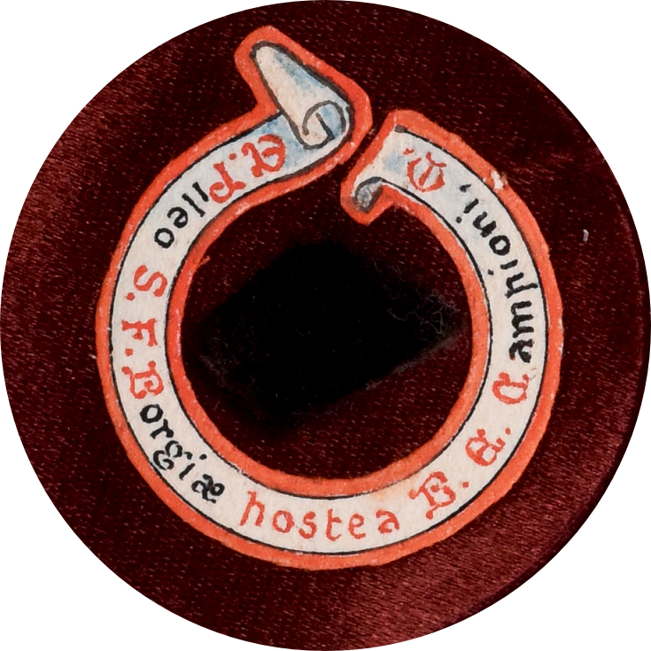Circular image with a small square of black fabric around which there is a manuscript scroll with the inscription: E. Pileo S. F. Borgiae hostea B. E. Campioni, M. The background is a deep red velvet.