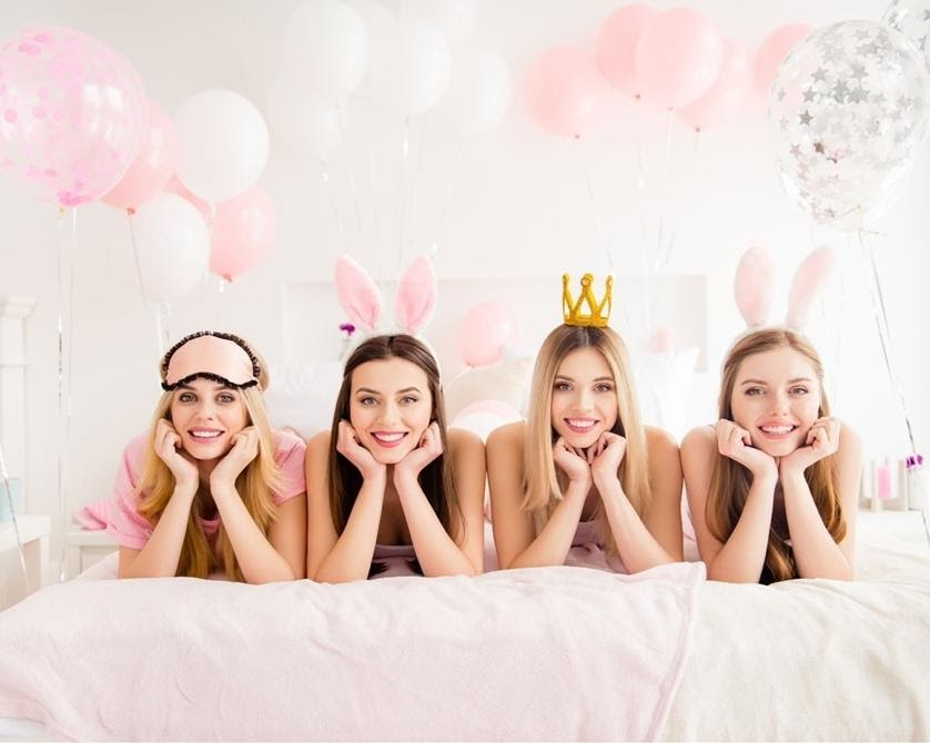 A group of women wearing bunny earsDescription automatically generated with low confidence