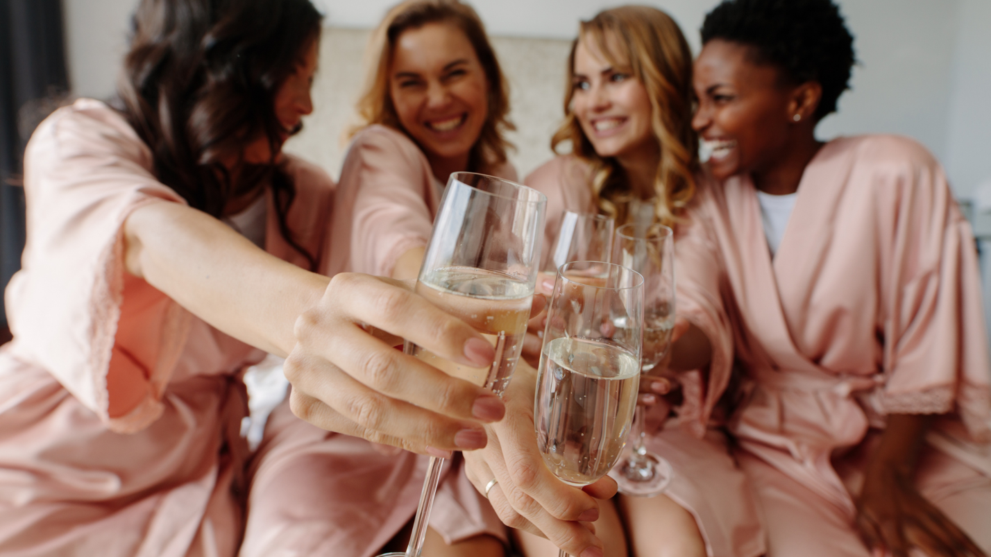 A group of women holding wine glassesDescription automatically generated with medium confidence