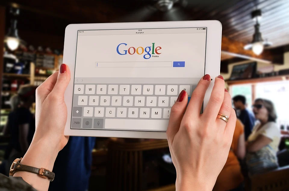girl with a tablet on her hands with google search open on the screen