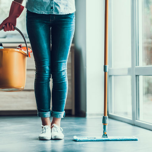 A lady ready to assist for cleaning services.