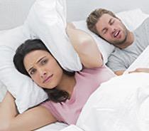 Woman awake sleep partner snoring
