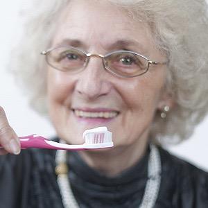 Oral Health Person Brushing their teeth