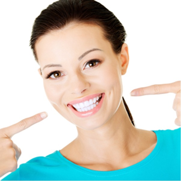 a person pointing at their bright white teeth