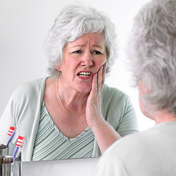Tooth Pain holding side of face