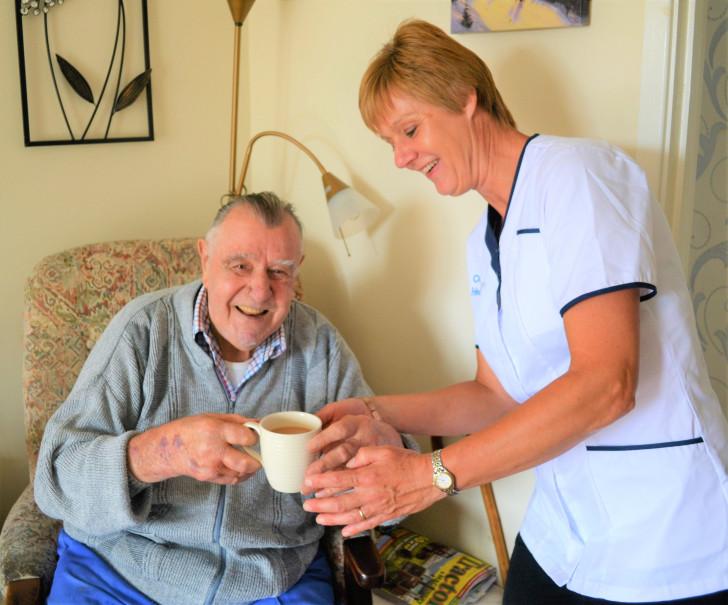 ocala carer delivering hot cup of tea to resident