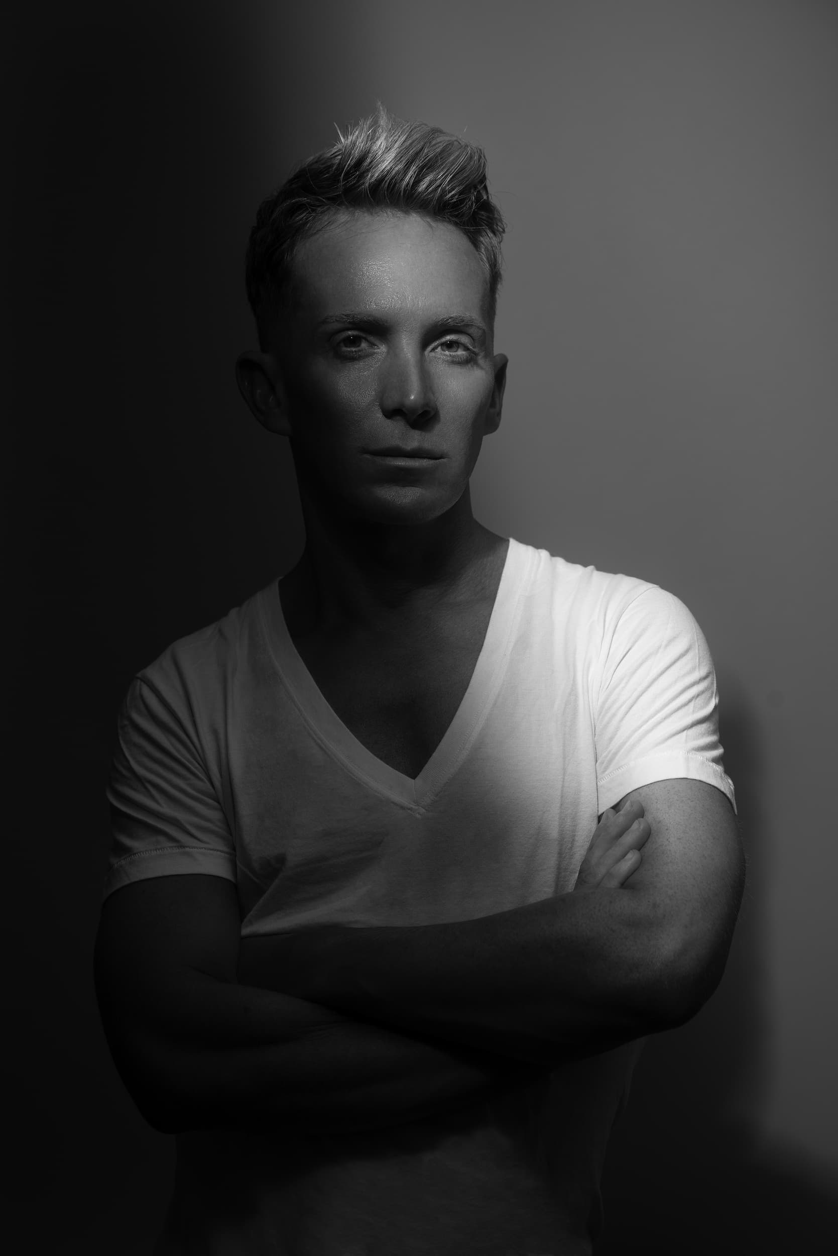 Black and white portrait of Paul Corrie with arms crossed.