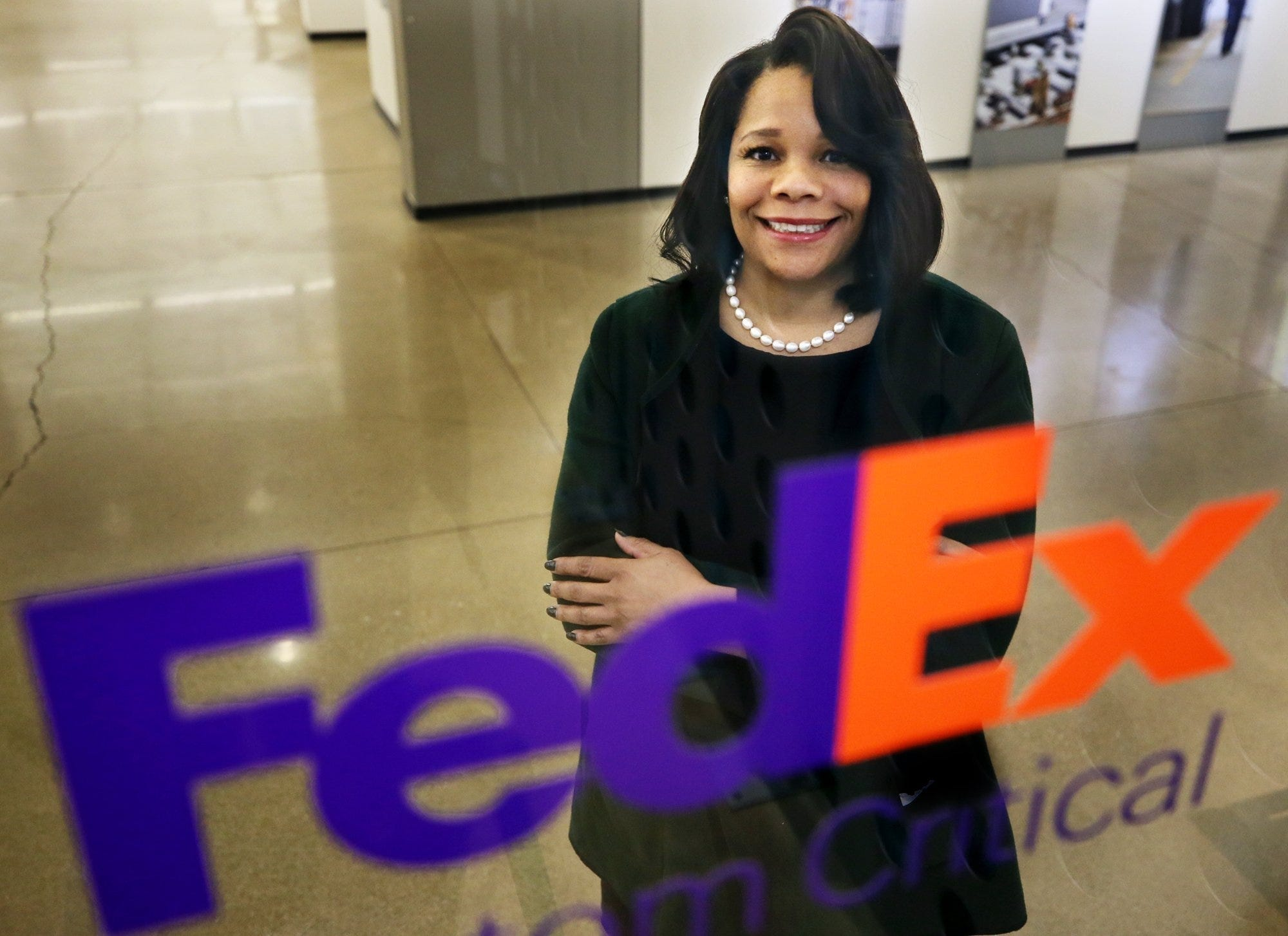Ramona Hood a FedEx receptionist who became a CEO standing confidently with a successful smile