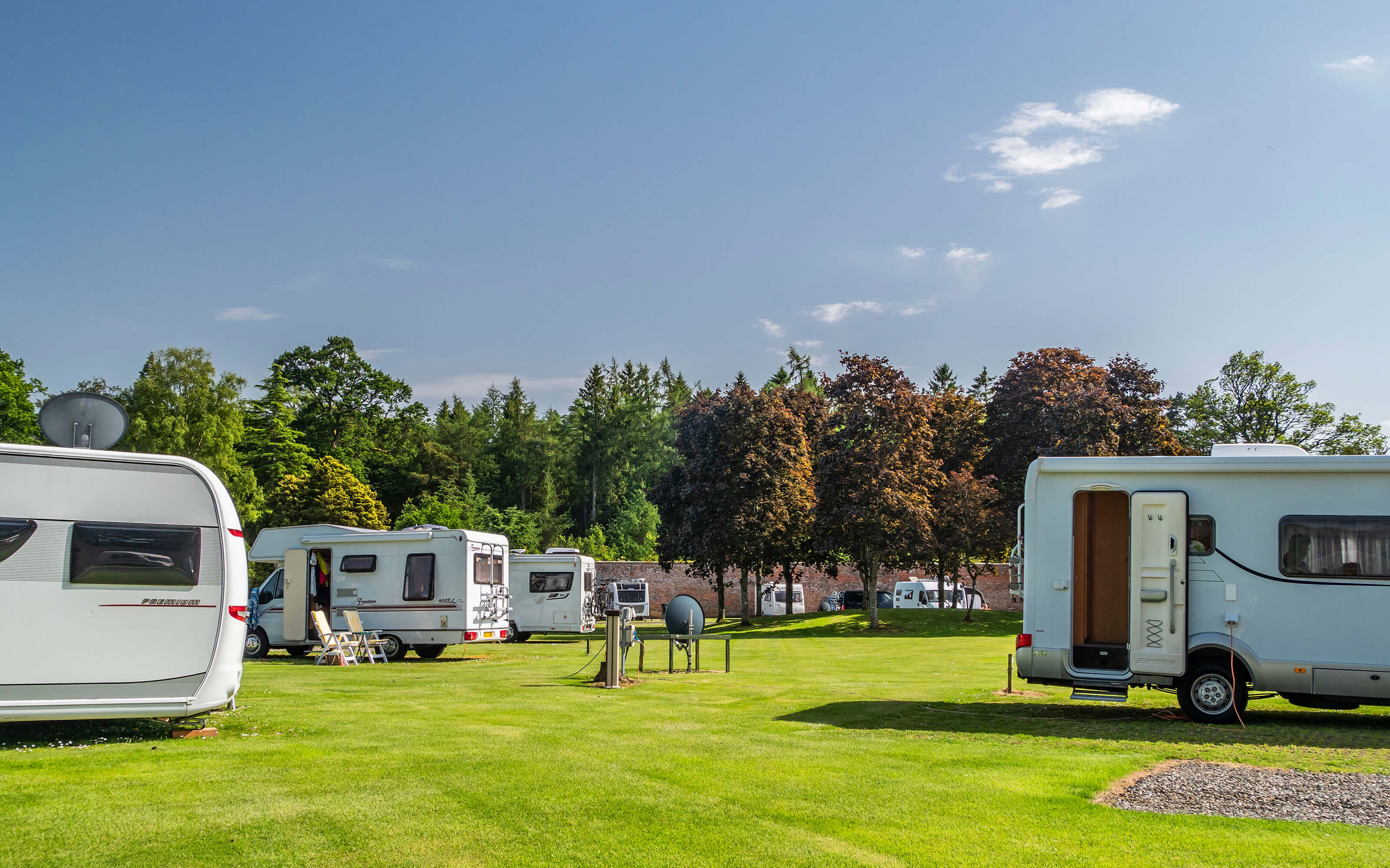 A group of motorhomes in the centre of the park.