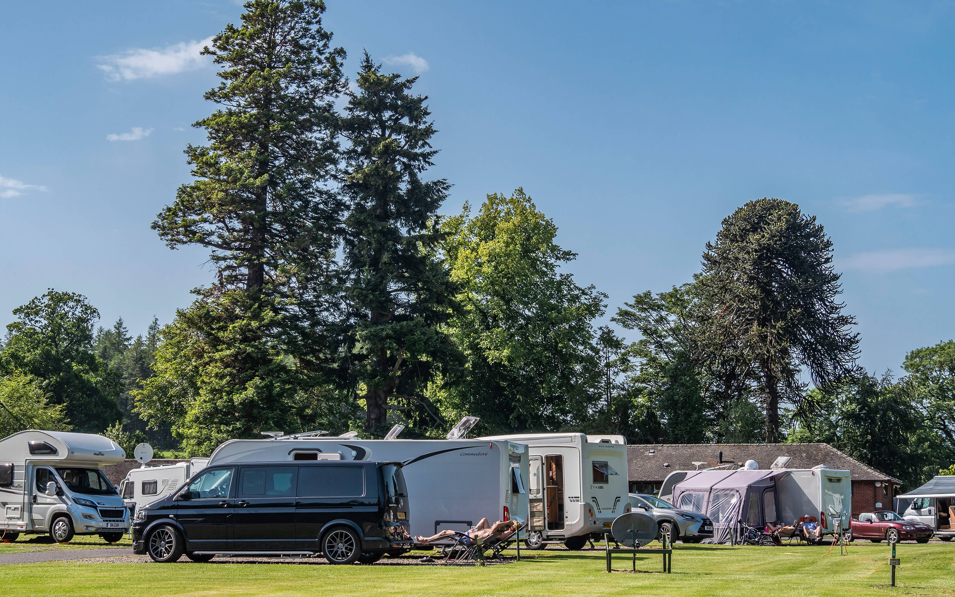 A group of caravans and motorhomes.