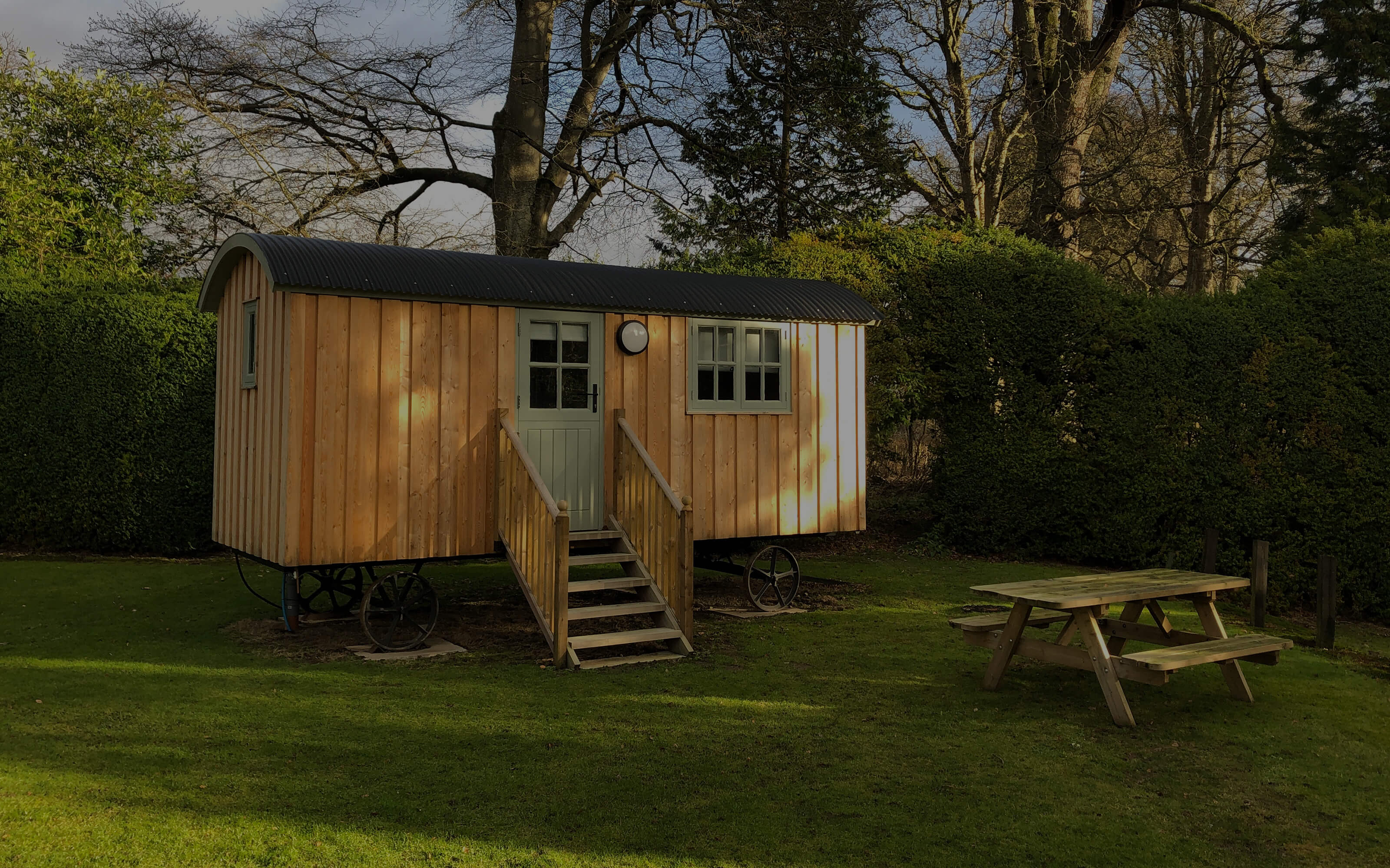 The outside of a newly built wooden shepherds hut.