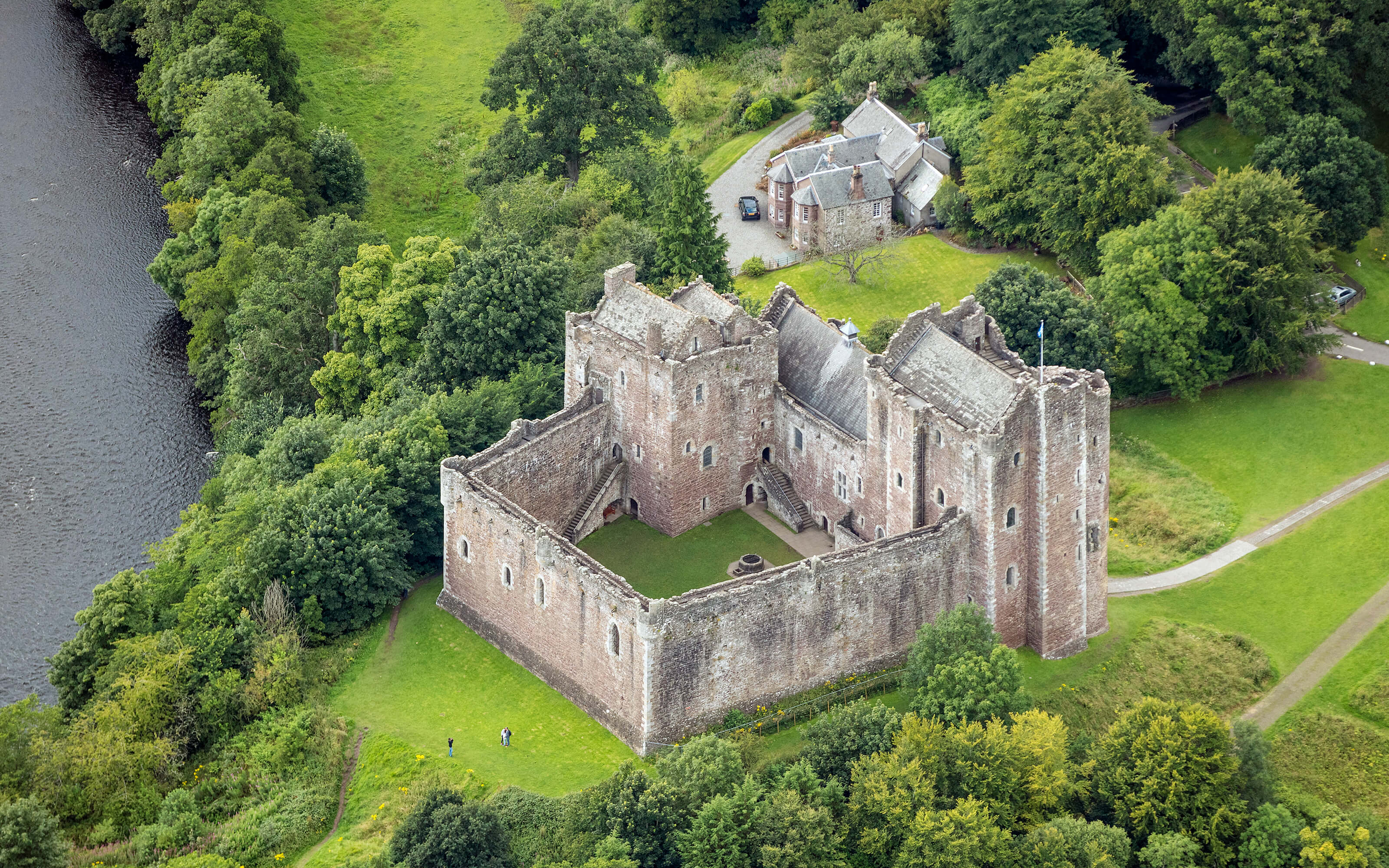 A dramatic aerial photograph of Doune Castle.