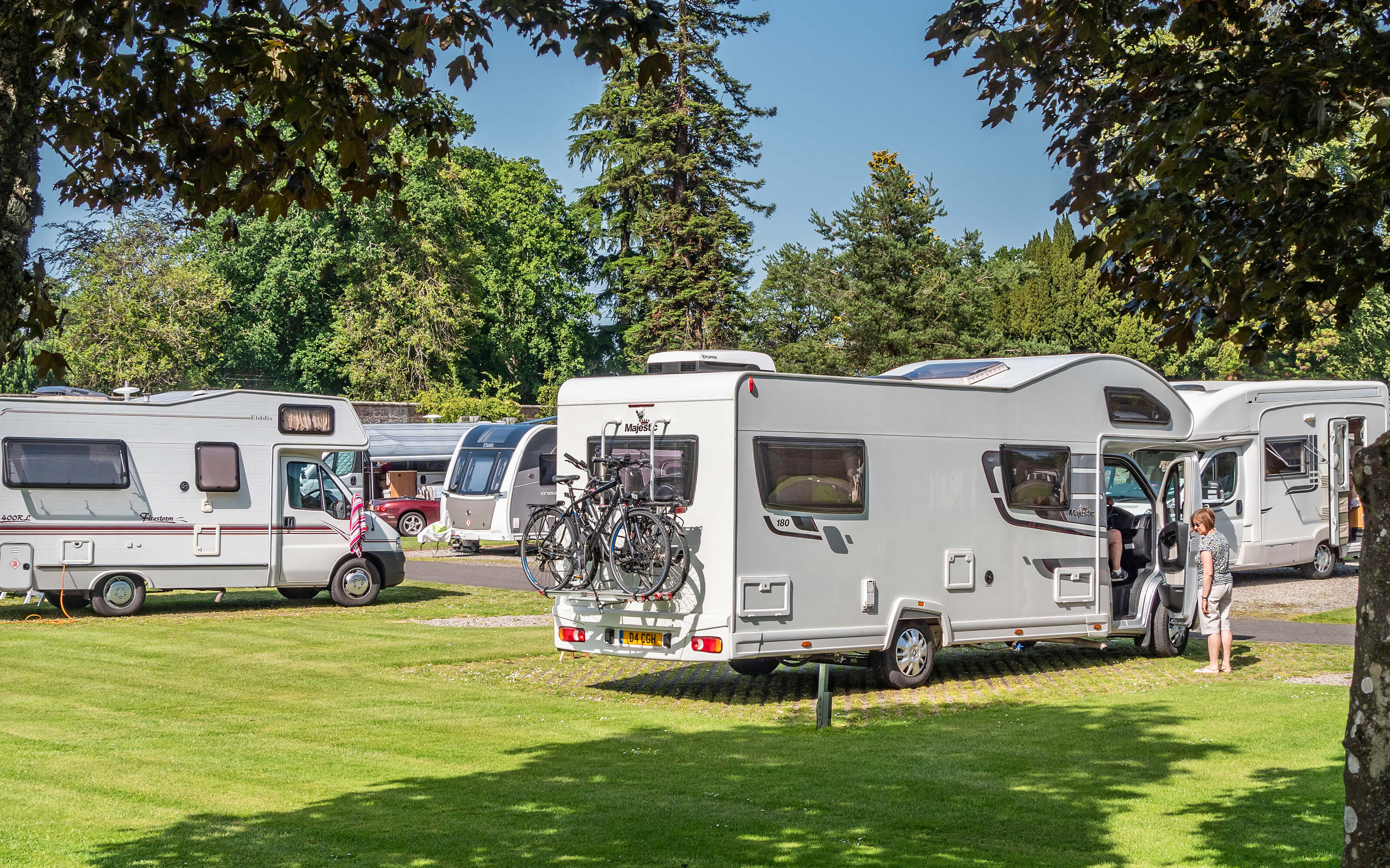 A group of motorhomes parked in the middle of the walled garden.