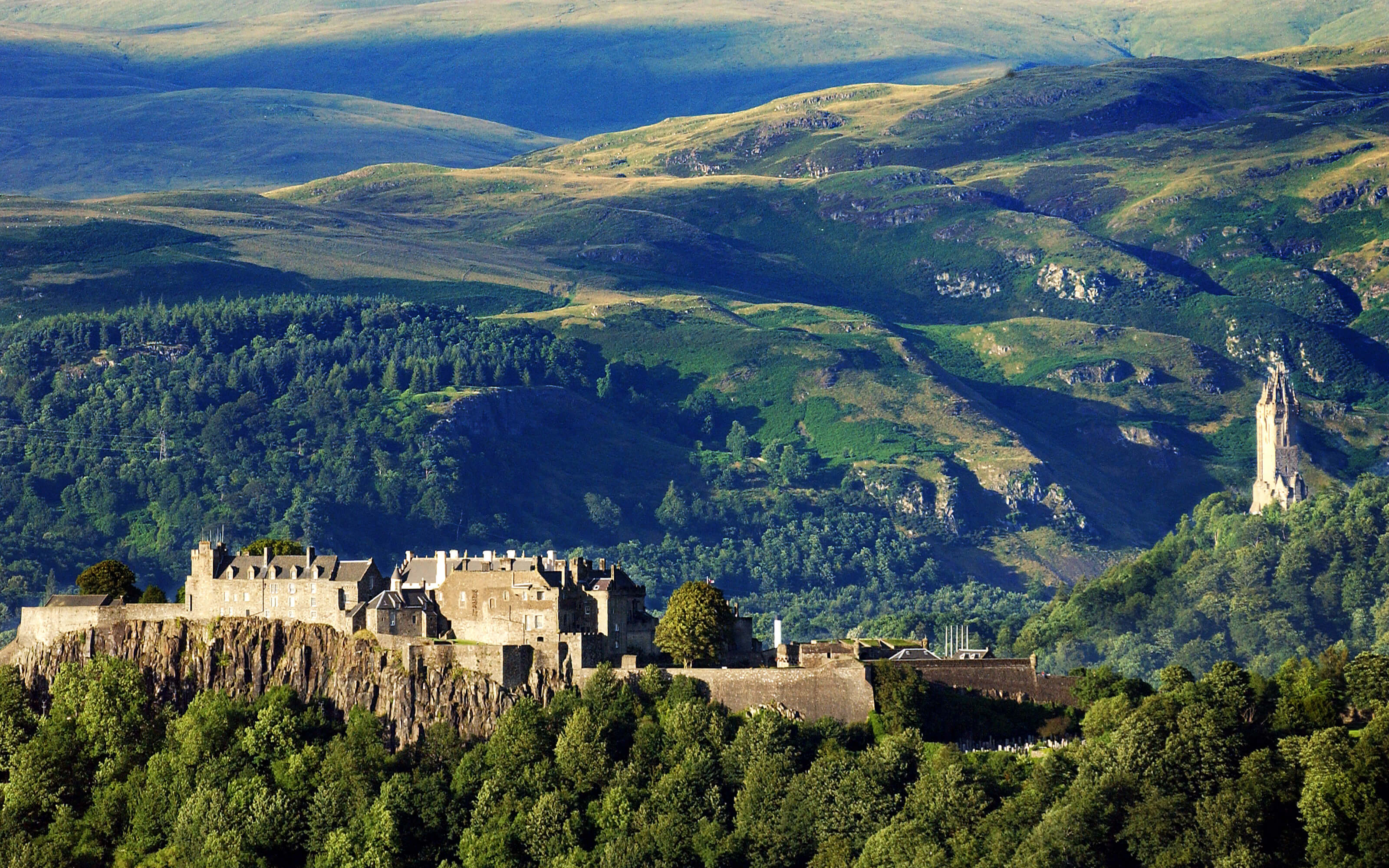 A dramatic photograph of Stirling Castle with the Wallace Monument.