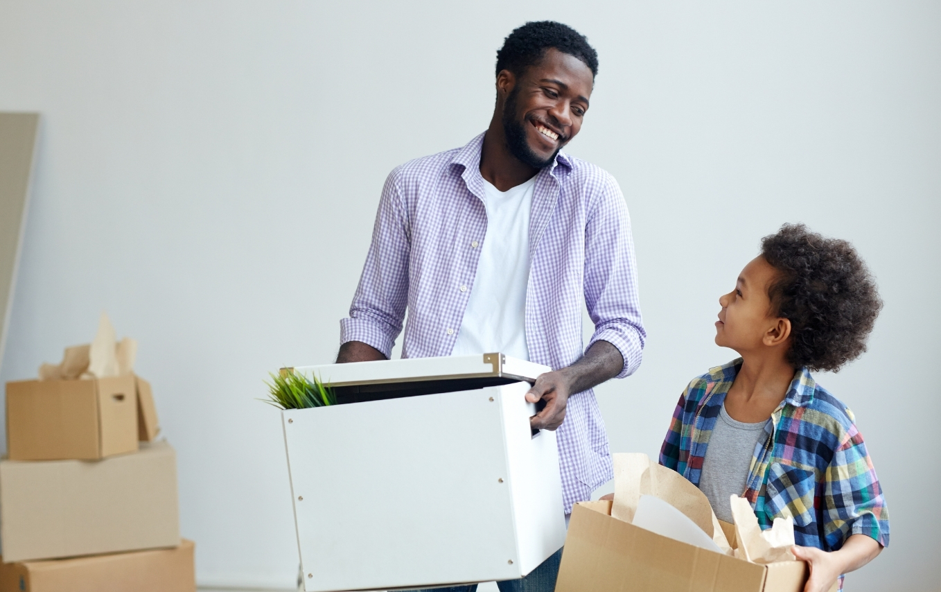 Man and son moving boxes.