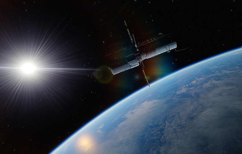 Satellite hovering above earth
