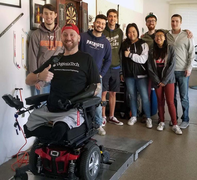 Virginia Tech students standing around their Challenger with his newly-completed project