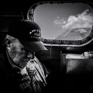 A veteran sitting in an aircraft