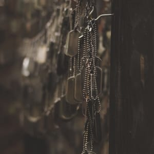 Dogtags hanging on a wall