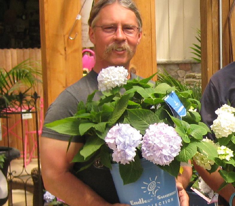 Wedel's family member holding a floral design