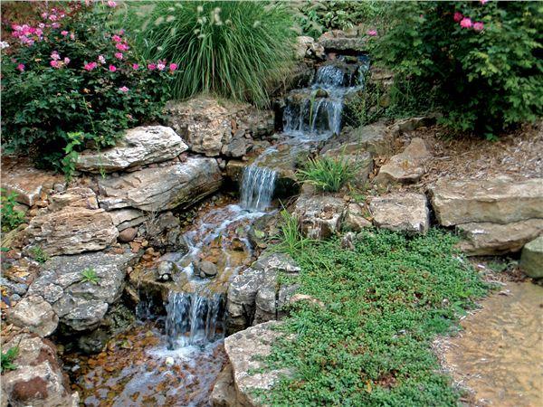 Small waterfall with beautiful greenery surrounding it